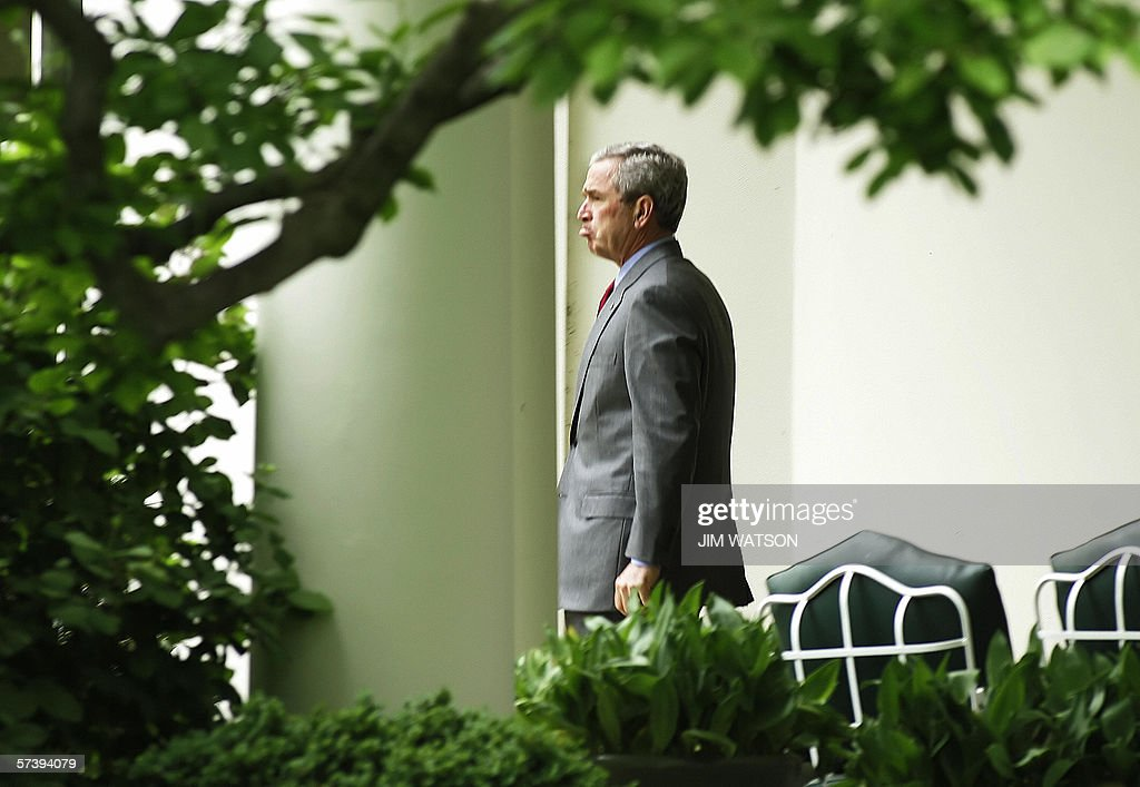 US President <a gi-track='captionPersonalityLinkClicked' href=/galleries/search?phrase=George+W.+Bush&family=editorial&specificpeople=122011 ng-click='$event.stopPropagation()'>George W. Bush</a> frowns as he departs the Oval Office of the White House in Washington, DC, 21 April 2006 enroute to San Jose, CA, to participate in a panel on the American PDT Competitiveness Initiative at Cisco Systems, Inc. AFP PHOTO/Jim WATSON