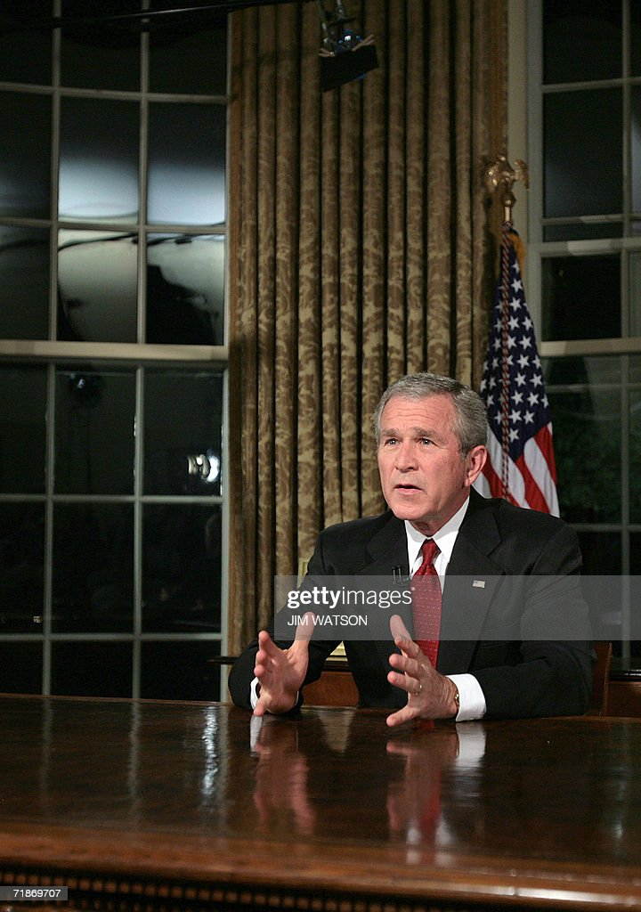 bush oval office. us president george w bush sits at his desk in the oval office of