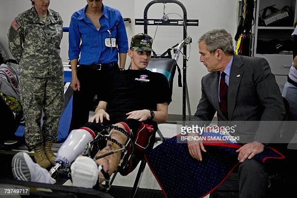 US President George W Bush speaks with Sgt David Gardener during a tour of the occupational therapy unit at Walter Reed Army Medical Center 30 March...