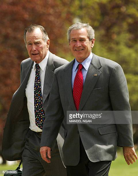 US President George W Bush walks from Marine One with his father former US president George HW Bush upon arriving at the Naval Observatory 16 April...