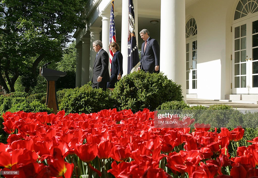 US President George W. Bush (L) walks to a press conference with Rob Portman (R), his nominee to replace Joshua Bolten as Office of Management and Budget (OMB) Director and nominee Susan Schwab, (C) who will be the new Trade Representitive in the Rose of the White House 18 April, 2006 in Washington, DC.