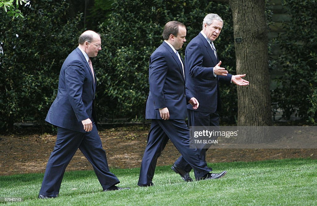 US President George W. Bush (R) walks with White House Press Secretary Scott McClellan (C) and Deputy Chief of Staff Joe Hagin (L) outside the Oval Office 05 May, 2006 in Washington, DC. McClellan earlier gave his last formal White House briefing in the Brady Press Briefing Room.
