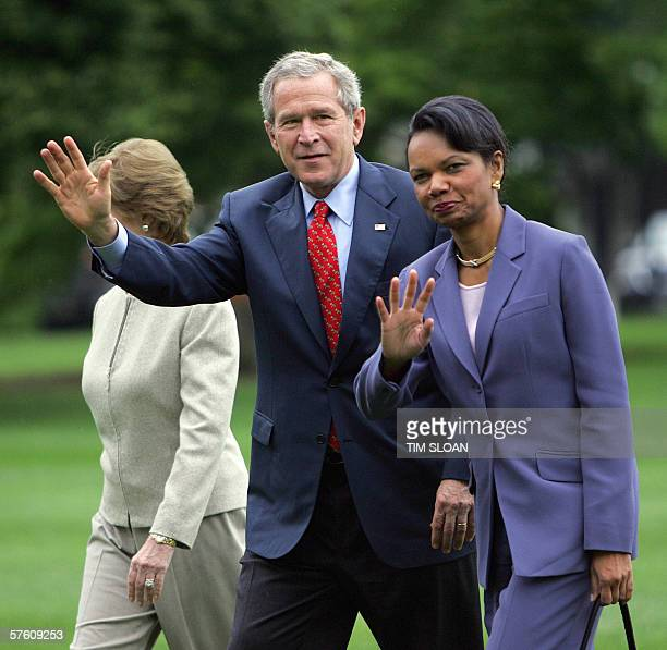 US President George W Bush waves with Secretary of State Condoleezza Rice and First Lady Laura Bush as they arrive at the White House 14 May 2006 on...
