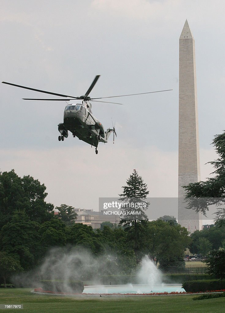 US presidential helicopter Marine One makes water spray out of a fountain as it arrives to land on the South Lawn of the White House in Washington,DC 24 July 2007 carrying President George W. Bush back from a visit to Charleston Air Force Base in South Carolina. AFP PHOTO/Nicholas KAMM