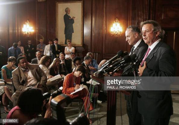 US Senator Charles Schumer DNY listens to former Ambassador Joseph Wilson during a 14 July 2005 Capitol Hill press conference in Washington where he...