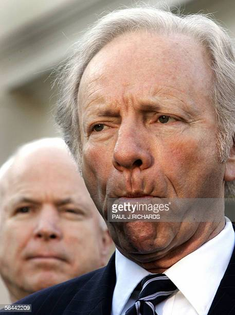 US Senators John McCain and Joseph Lieberman DCT listen as reporters ask questions about US President Bush secretly authorizing the National Security...
