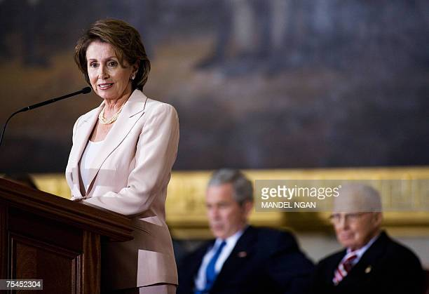 US Speaker of the House Nancy Pelosi speaks as US President George W Bush and Congressional Gold Medal recipient Norman Borlaug watch during a...
