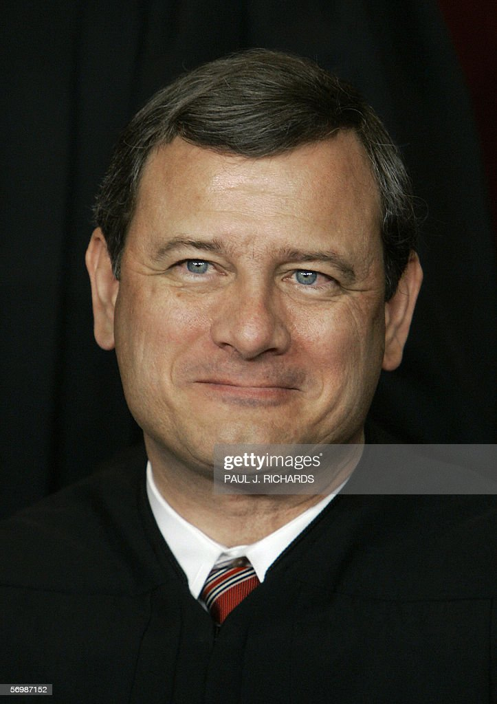 US Supreme Court Chief Justice John Roberts smiles as the justices pose for their class photo 03 March 2006 inside the Supreme Court in Washington, DC. AFP PHOTO/Paul J. RICHARDS