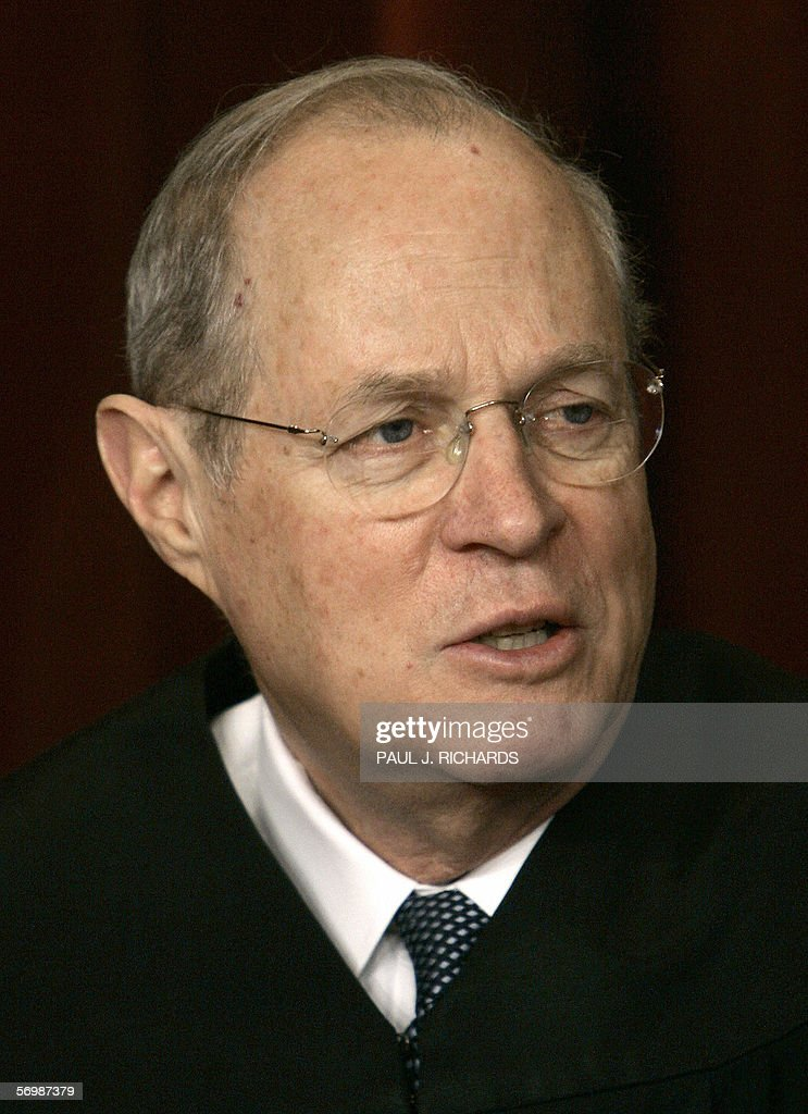 US Supreme Court Justice Anthony Kennedy looks on as the justices pose for their class photo 03 March 2006 inside the Supreme Court in Washington, DC. AFP PHOTO/Paul J. RICHARDS