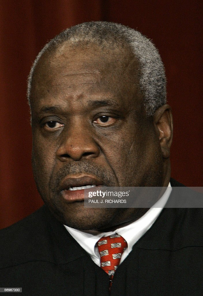 US Supreme Court Justice <a gi-track='captionPersonalityLinkClicked' href=/galleries/search?phrase=Clarence+Thomas+-+Judge&family=editorial&specificpeople=217528 ng-click='$event.stopPropagation()'>Clarence Thomas</a> looks on as the justices pose for their class photo 03 March 2006 inside the Supreme Court in Washington, DC. AFP PHOTO/Paul J. RICHARDS