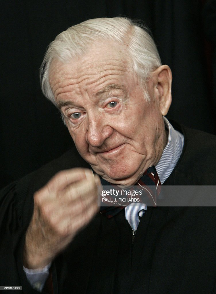 US Supreme Court Justice <a gi-track='captionPersonalityLinkClicked' href=/galleries/search?phrase=John+Paul+Stevens&family=editorial&specificpeople=218002 ng-click='$event.stopPropagation()'>John Paul Stevens</a> pauses as the justices pose for their class photo 03 March 2006 inside the Supreme Court in Washington, DC. AFP PHOTO/Paul J. RICHARDS