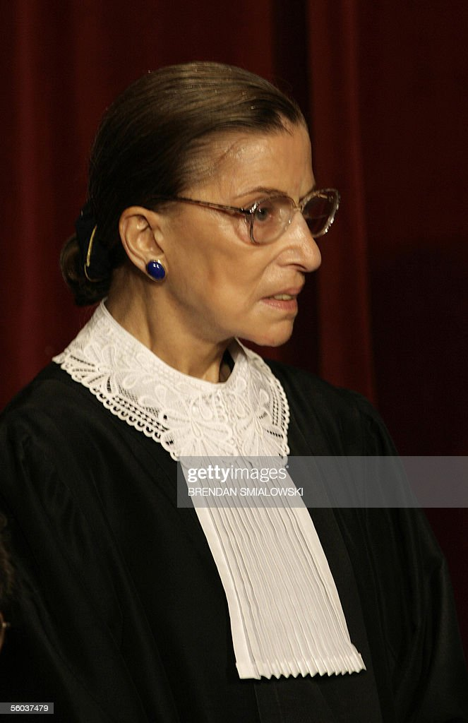 US Supreme Court Justice Ruth Bader Ginsburg sits for a class photo at the Supreme Court 31 October 2005 in Washington DC The Justices sat for their...