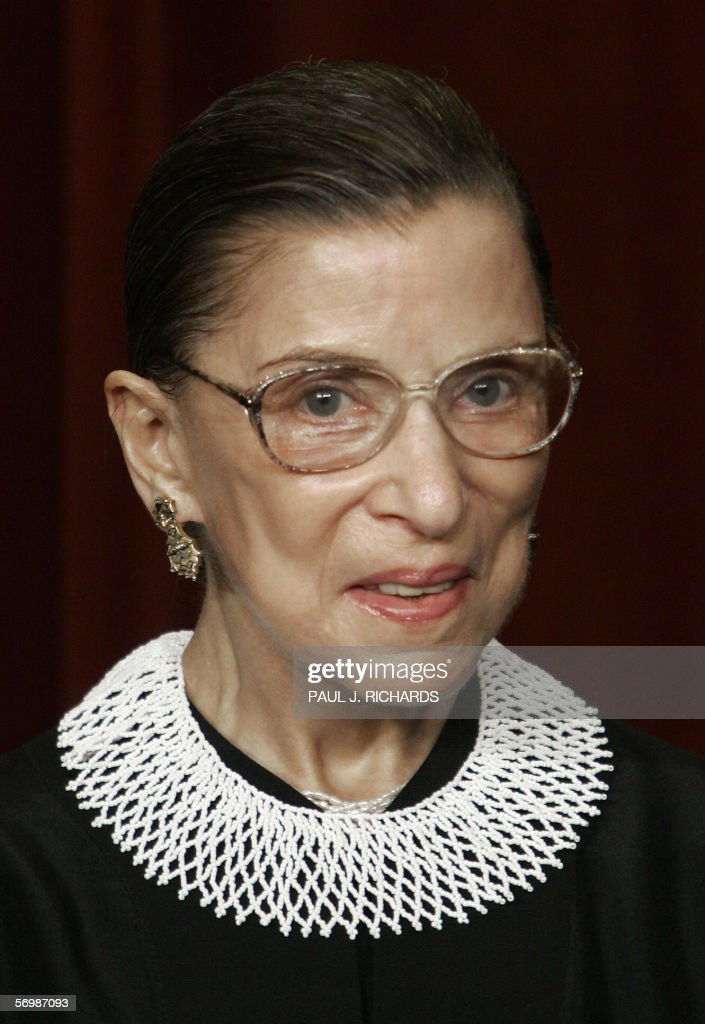 US Supreme Court Justice <a gi-track='captionPersonalityLinkClicked' href=/galleries/search?phrase=Ruth+Bader+Ginsburg&family=editorial&specificpeople=199152 ng-click='$event.stopPropagation()'>Ruth Bader Ginsburg</a> looks at the camera as the justices pose for their class photo 03 March 2006 inside the Supreme Court in Washington, DC. AFP PHOTO/Paul J. RICHARDS