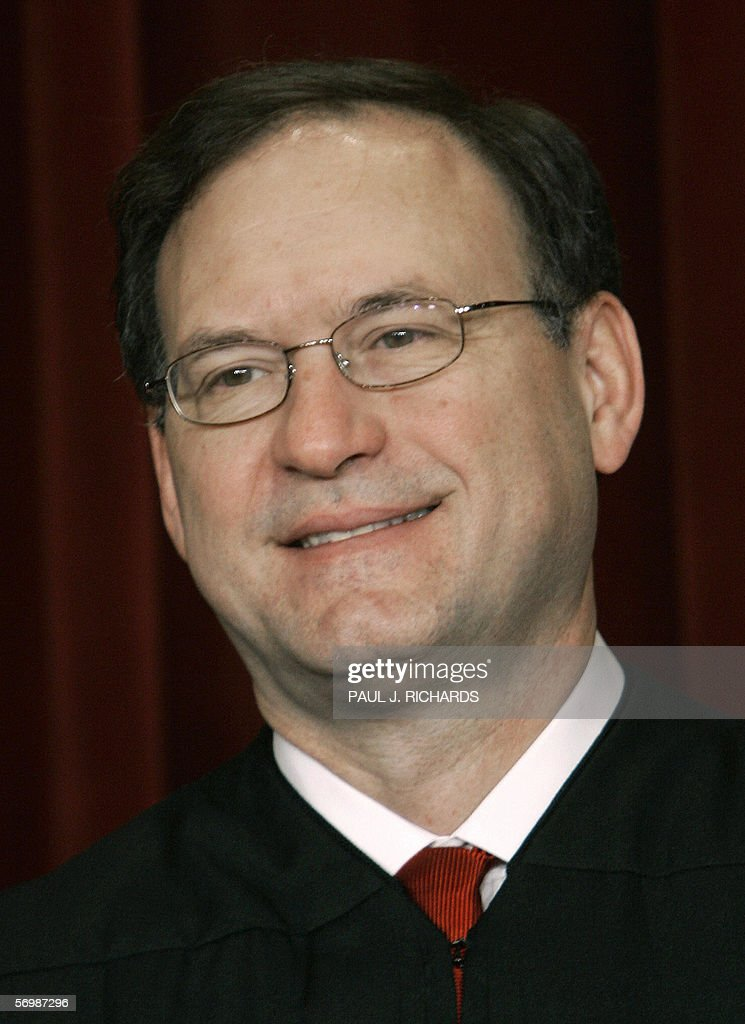 US Supreme Court Justice <a gi-track='captionPersonalityLinkClicked' href=/galleries/search?phrase=Samuel+Alito&family=editorial&specificpeople=274708 ng-click='$event.stopPropagation()'>Samuel Alito</a> amiles as the justices pose for their class photo 03 March 2006 inside the Supreme Court in Washington, DC. AFP PHOTO/Paul J. RICHARDS