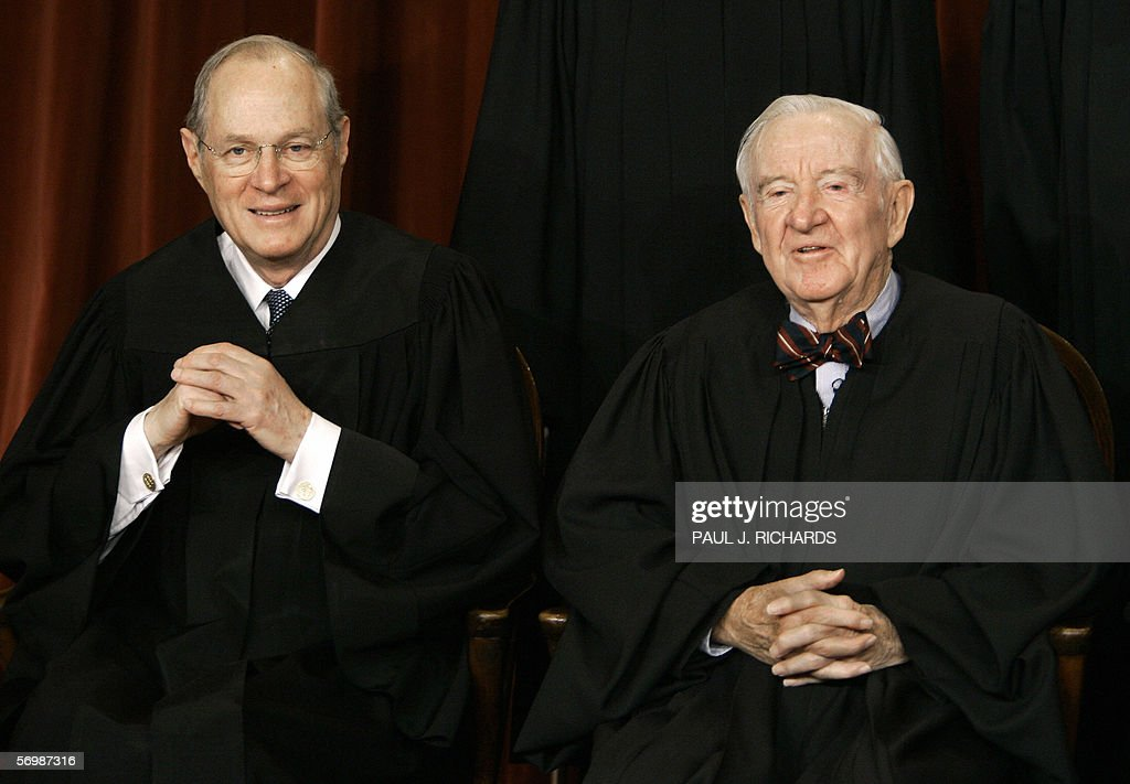 US Supreme Court justices Anthony Kennedy (L) and John Paul Stevens smile as the justices pose for their class photo 03 March 2006 inside the Supreme Court in Washington, DC. AFP PHOTO/Paul J. RICHARDS