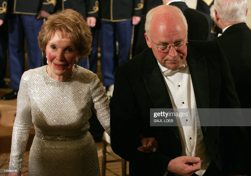 US Vice President Dick Cheney escorts former US First Lady Nancy Reagan after a performance by violinist Itzhak Perlman in the East Room at the White House following a State Dinner for Queen Elizabeth II in Washington, DC, 07 May 2007 The British monarch and the US president solemnly toasted the tight bonds between their countries, in the grandest White House dinner of Bush's administration.