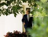White House Deputy Chief of Joe Hagin walks through the Colonnade 29 May 2007 upon return to the White House in Washington DC Hagin was travelling...