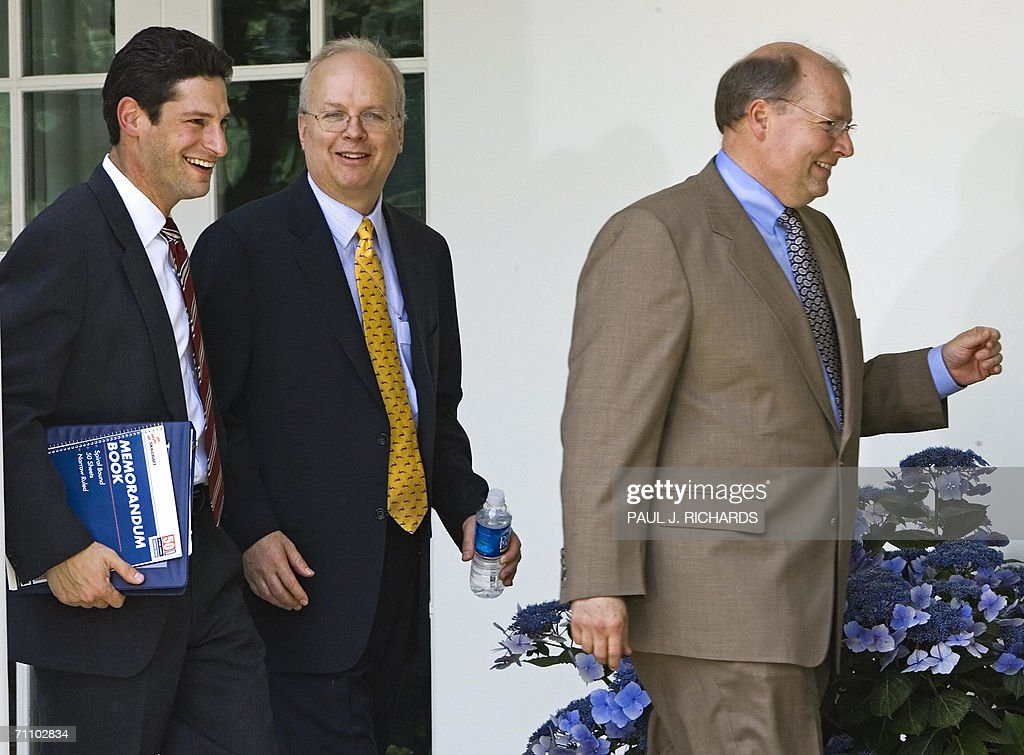 White House Deputy Chiefs of Staff Joel D. Kaplan(L), Karl Rove, and Joe Hagen, walk through the Colonnade of the White House after the swearing in ceremony of Brett Kavanaugh, as Judge to the US Court of Appeals for the District of Columbia 01 June 2006 in the Rose Garden of the White House in Washington,DC. AFP Photo/Paul J. Richards