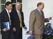 White House Deputy Chiefs of Staff Joel D Kaplan Karl Rove and Joe Hagen walk through the Colonnade of the White House after the swearing in ceremony...
