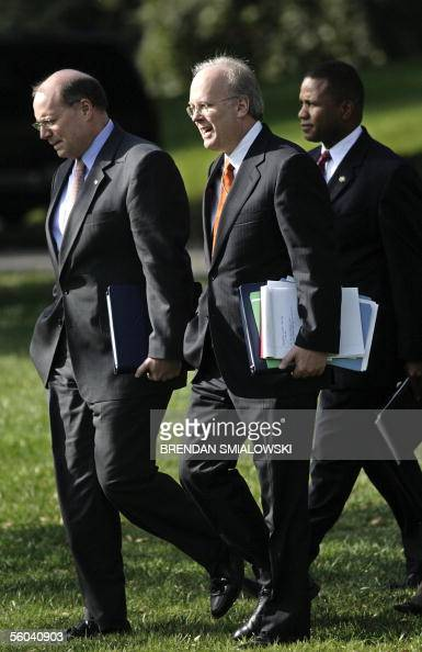 White House Deputy Chiefs of Staff Karl Rove and Joe Hagin walk with Domestic Policy Most advisor Claude Allen to Marine One on the South Lawn of the...