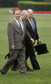 White House spokesperson Scott McClellan walks with presidental advisor Karl Rove and deputy White House chief of staff Joe Hagin from Marine One to...