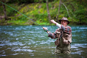 USA, Washington, Vancouver, Senior man fishing on river