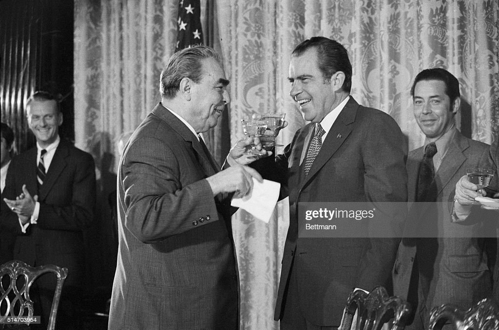 While toasting the signing of four agreements between the US and Soviet Union with Pres. Nixon, Soviet leader <a gi-track='captionPersonalityLinkClicked' href=/galleries/search?phrase=Leonid+Brezhnev&family=editorial&specificpeople=93686 ng-click='$event.stopPropagation()'>Leonid Brezhnev</a> spilled his champagne and then hid his face behind his napkin. The toasting resumed at the State Dept. where the agreements were signed 6/19 as a part of their summit meetings. 6/19/1973