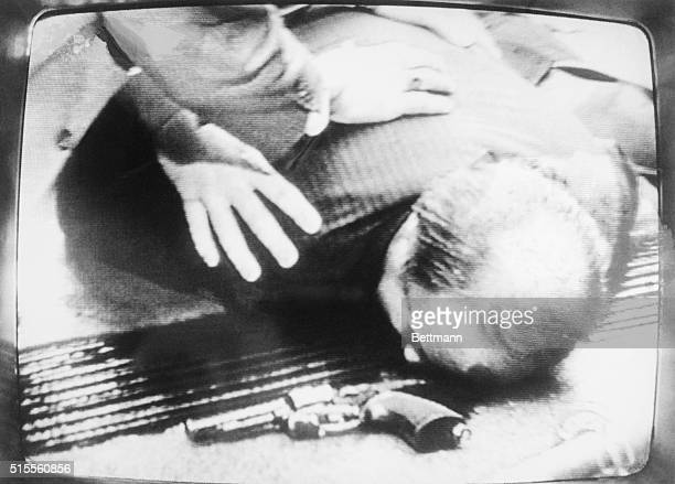 White House press secretary Jim Brady lies wounded on the sidewalk here after a gunman fired several shots at President Reagan and his party after he...