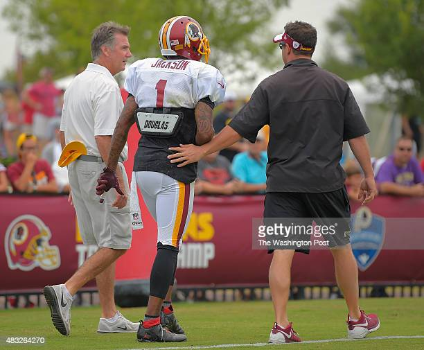 Washington wide receiver DeSean Jackson center walks off the field and is flanked by team president Bruce Allen left and team trainer Larry Hess...