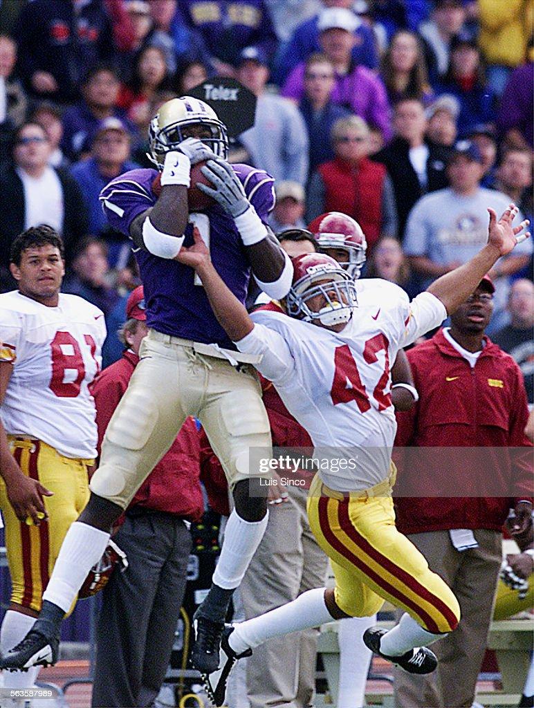 Washington wide receiver Reggie Williams makes reception over USC