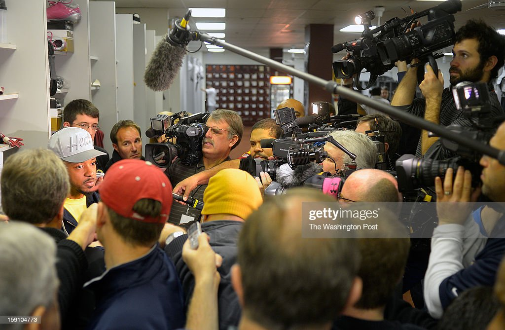 Washington wide receiver Santana Moss talks to the media as he cleans out his locker at the Redskins practice facility in Ashburn Va. This, after their season ending loss the day before to the Seattle Seahawks in the first round of the NFC playoffs.