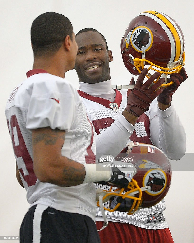 Washington wide receivers Dezmon Briscoe (19), left, and Washington wide receiver Pierre Garcon (88) finish warm ups as the Washington Redskins practice for the upcoming playoff game against the Seattle Seahawks in their indoor practice facility at Redskins Park in Ashburn VA, January 2, 2012 .