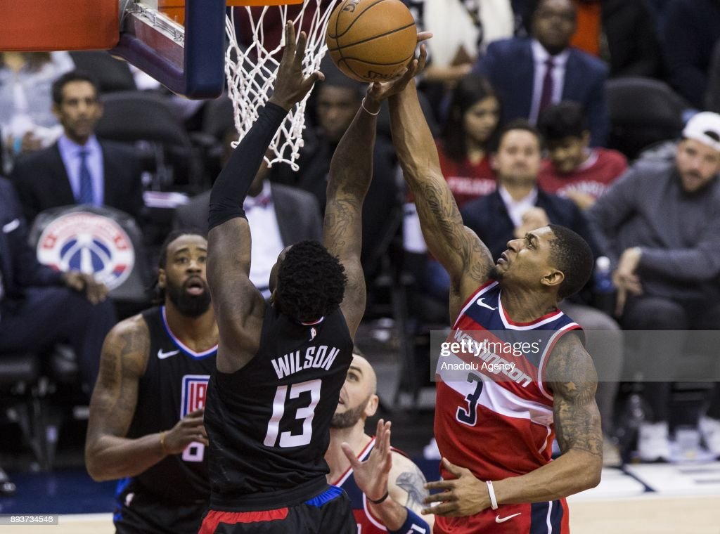 Washington Wizard Bradley Beal (3) blocks a shot from Los Angeles Clipper Jamil Wilson (13) at the Capital One Arena in Washington, USA on December 15, 2017.