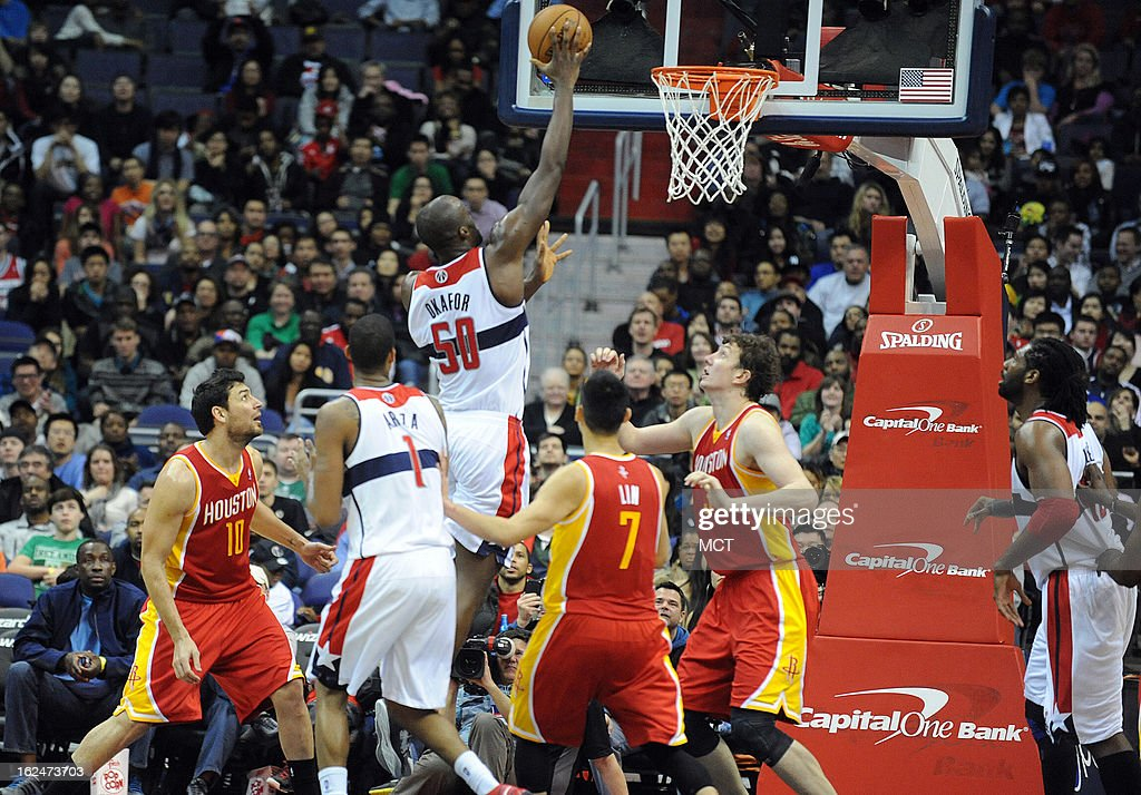 Washington Wizards center Emeka Okafor (50) drives to the basket during second-half action against the Houston Rockets at the Verizon Center in Washington, D.C., Saturday, February 23, 2013. The Wizards defeated the Rockets, 105-103.