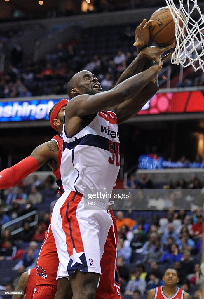 Washington Wizards center Emeka Okafor (50) gets fouled from behind by Atlanta Hawks small forward Josh Smith (5) in the third quarter at the Verizon Center in Washington, D.C., Saturday, January 12, 2013. The Wizards defeated the Hawks, 93-83.