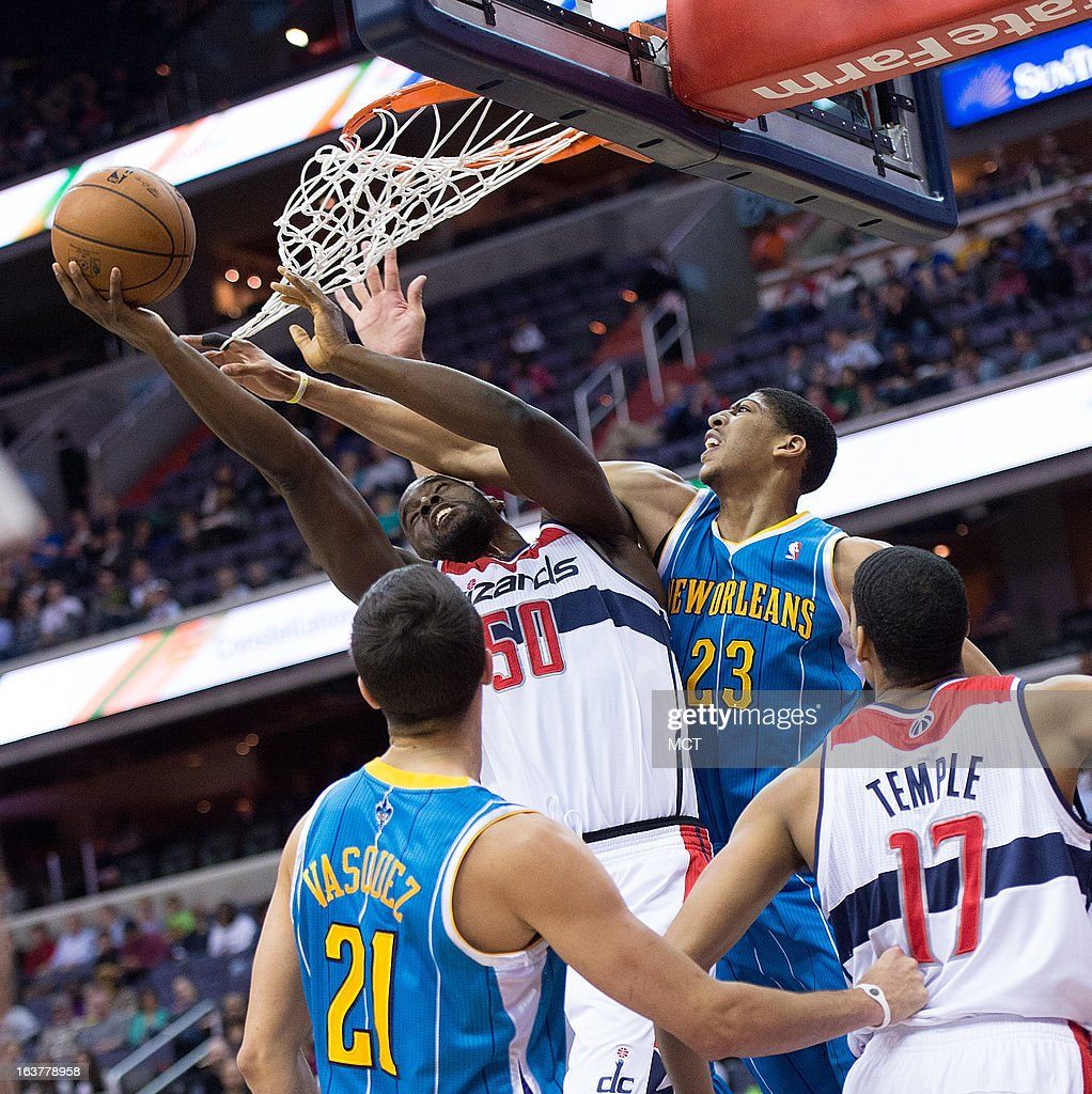 Washington Wizards center Emeka Okafor is fouled by New Orleans Hornets power forward Anthony Davis during the first half of their game played at the...