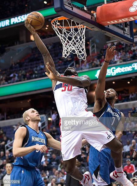 Washington Wizards center Emeka Okafor scores over Minnesota Timberwolves center Greg Stiemsma left and power forward Derrick Williams during the...