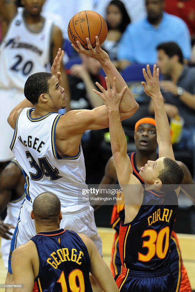 Washington Wizards center JaVale McGee (34) shoots over Golden State Warriors guard Stephen Curry (30)during the game at the Verizon Center on Tuesday, April 6, 2010. The Wizards defeated the Warriors 112-94.
