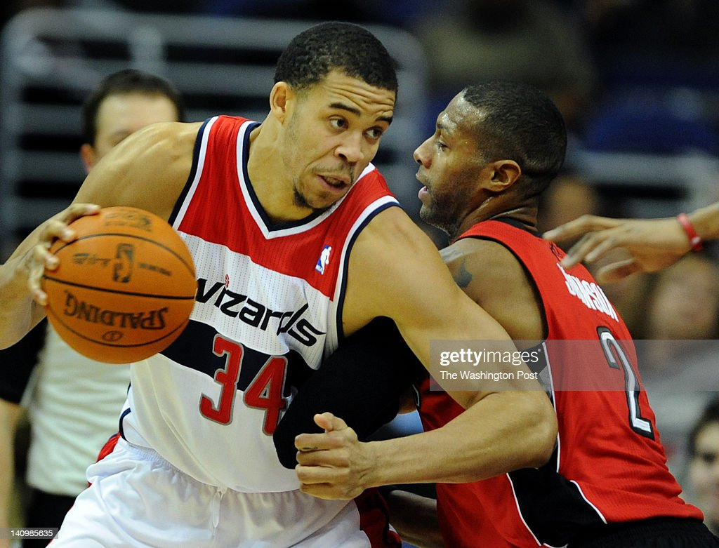 Washington Wizards center JaVale McGee tries to muscle his way past Toronto Raptors small forward James Johnson during the game at the Verizon Center...