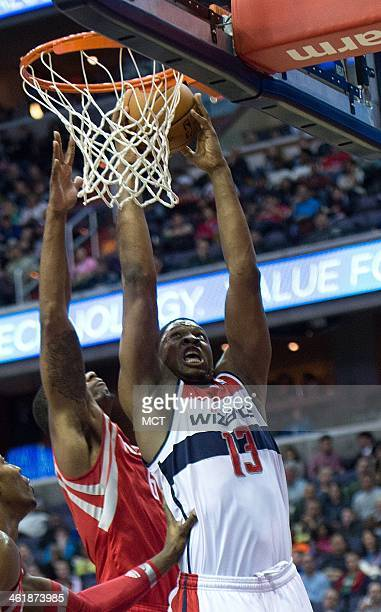 Washington Wizards center Kevin Seraphin shoots over Houston Rockets power forward Terrence Jones during the second half of their game played at the...