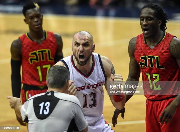 WASHINGTON DC APRIL Washington Wizards center Marcin Gortat argues with referee Monty McCutchen after being called for a foul during the second half...