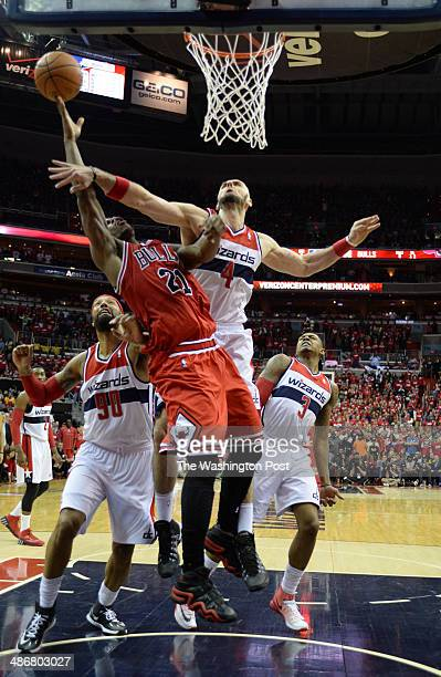 Washington Wizards center Marcin Gortat fouls Chicago Bulls guard Jimmy Butler during second half action as the Washington Wizards play the Chicago...