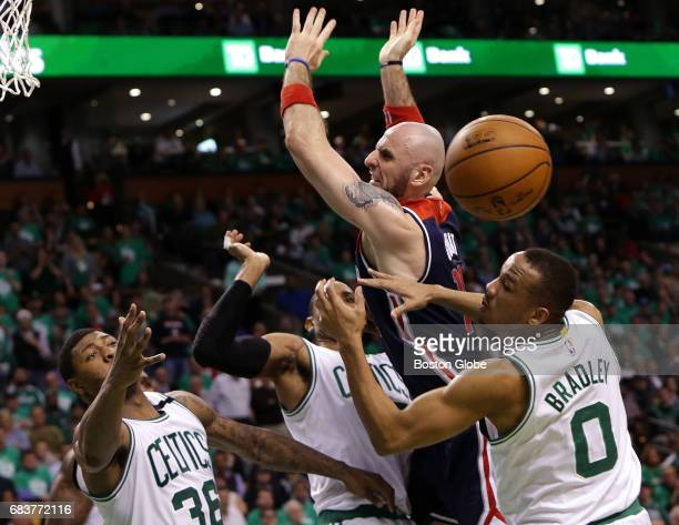 Washington Wizards center Marcin Gortat loses the ball out of bounds as he is swarmed by Smart Horford and Bradley during the third quarter The...