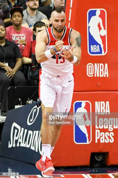 Washington Wizards center Marcin Gortat makes a hammer sign after scoring in the second half against the Philadelphia 76ers on October 18 2017 at the...
