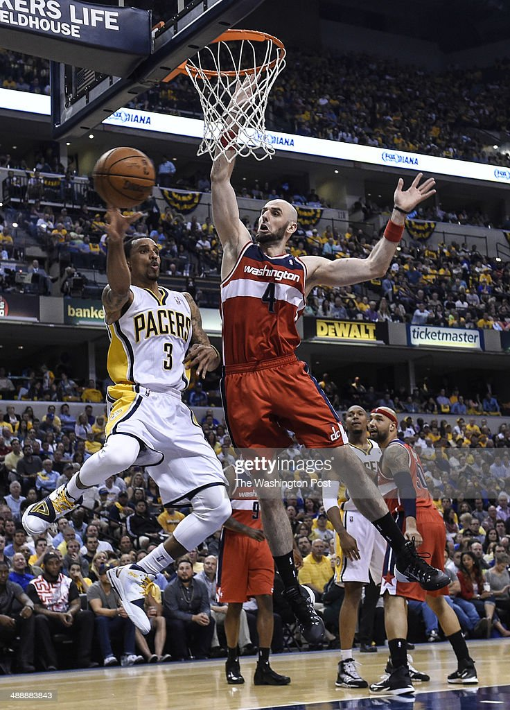 Washington Wizards center Marcin Gortat (4), right, forces Indiana Pacers guard George Hill (3) to pass the ball under the basket during the second half of the second game of the Eastern Conference semifinals between the Washington Wizards and the Indiana Pacers at Bankers Life Fieldhouse on Wednesday, May 7, 2014. The Indiana Pacers defeated the Washington Wizards 86-82 to tie the series with one game each.