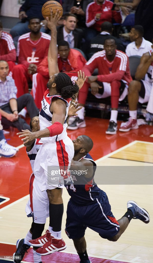Washington Wizards center Nene (42) blocks the shoot of Atlanta Hawks power forward Ivan Johnson (44) during the second half of their game played at the Verizon Center in Washington, D.C., Tuesday, December 18, 2012. Atlanta defeated Washington 100-95 in overtime.