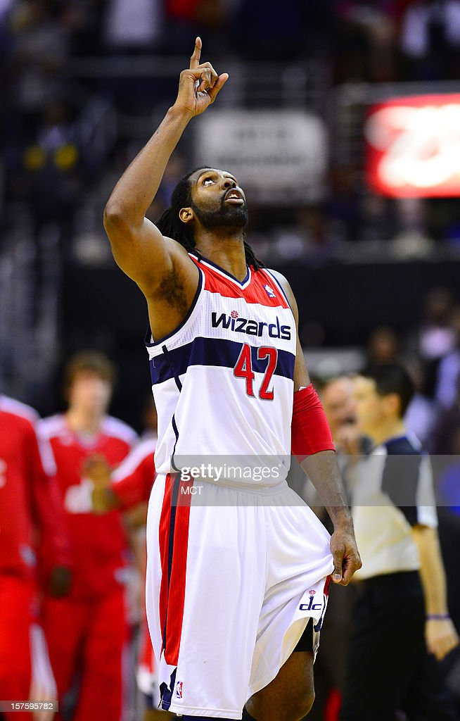 Washington Wizards center Nene (42) celebrates following a 105-101 victory over the Miami Heat at the Verizon Center in Washington, D.C., Tuesday, December 4, 2012.