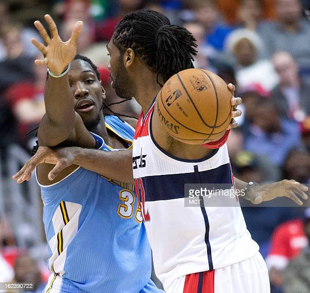 Washington Wizards center Nene is pressured by Denver Nuggets small forward Kenneth Faried during the first half of their game played at the Verizon...