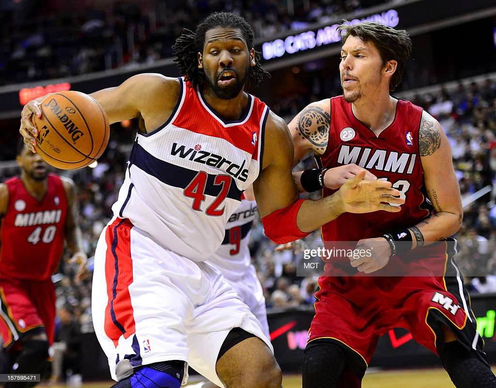 Washington Wizards center Nene (42) tries to control the ball against Miami Heat small forward Mike Miller (13) in the third quarter at the Verizon Center in Washington, D.C., Tuesday, December 4, 2012.