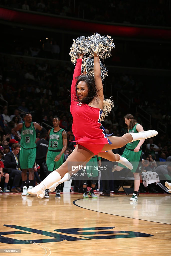 A Washington Wizards dance member performs during a game against the Boston Celtics at the Verizon Center on April 2, 2014 in Washington, DC.